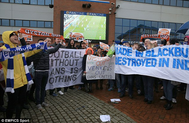 SUPPORTERS DIRECT: Blackpool and Blackburn fans stand together in ownership protest